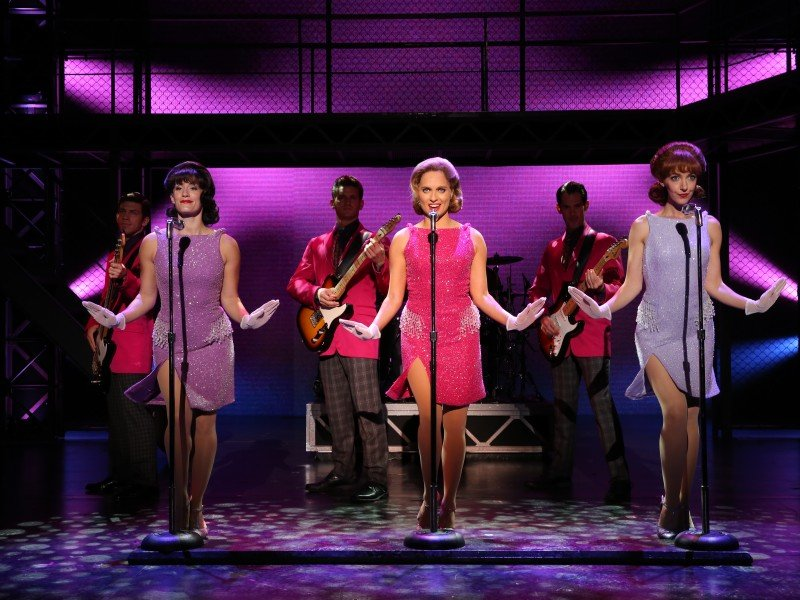 Some of the vintage costumes and wigs from Jersey Boys. Foreground: Marlana Dunn, Leslie Rochette, and Jaycie Dotin; Background: Keith White, Tommaso Antico, and John Rochette. Photo by Joan Marcus