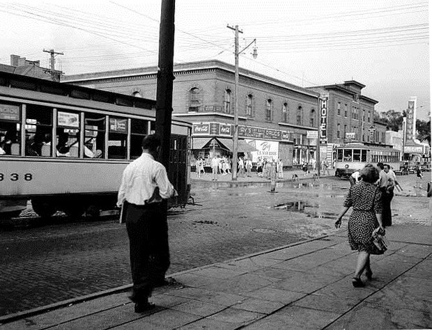 The 14th Avenue and Fourth Street corner shows streetcar traffic and Gray's Drug Store. Photo from Minneapolis CPED and Minnesota Historical Society.