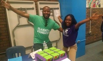 Timothy Sayon of the Sanneh/Conway Recreation Program and eighth grade student Michaela Kamara.