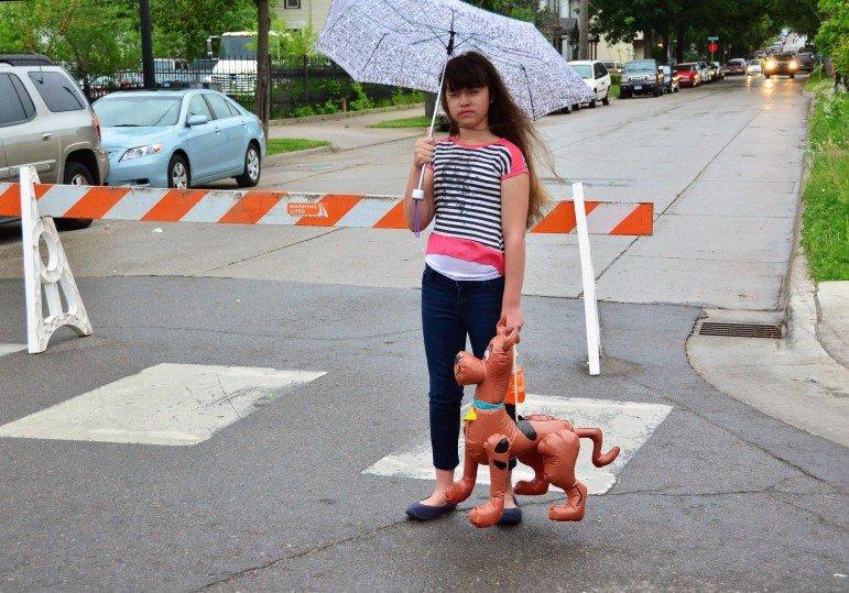 Girl with inflatable dog