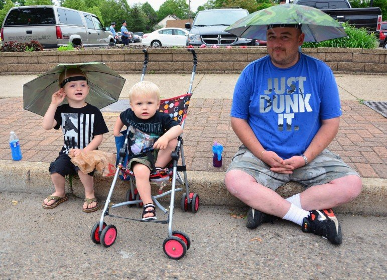 Family with umbrella hats