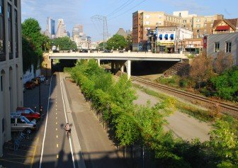 The trench, created as a below-grade railroad bed, cuts diagonally through Dinkytown and affords views of Downtown and supports the Dinkytown Greenway bike path as well as a service road and limited railroad use. Photo by Bill Huntzicker