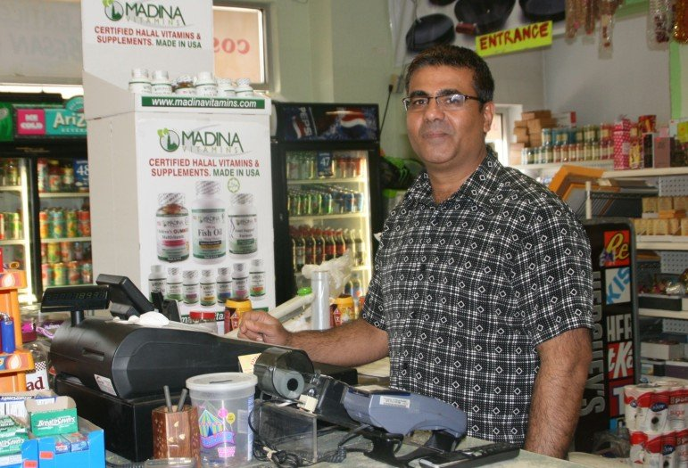 Faheem Khan does everything, including working the register.