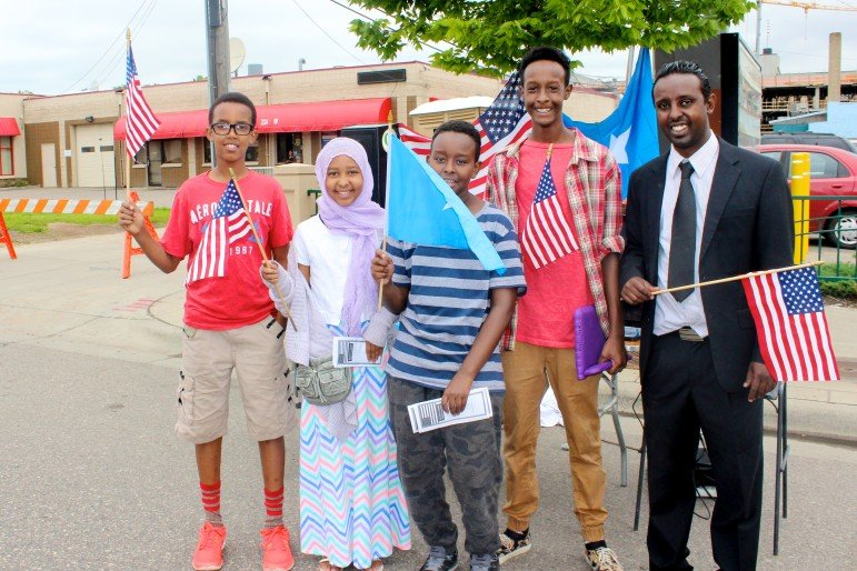 Workers of the Average Mohamed booth pose with Somali and American flags.