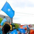 Flags waved while DJs played music at the Somali Independence Day festival in Minneapolis on June 13.