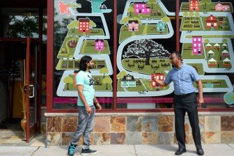 Muhammad Jiwa and Ruhel Islam speak outside of Gandhi Mahal Restaurant on Thursday afternoon. Members of Minnesota Interfaith Power & Light have been working with communities of many different religious backgrounds to discuss the topic of climate change.