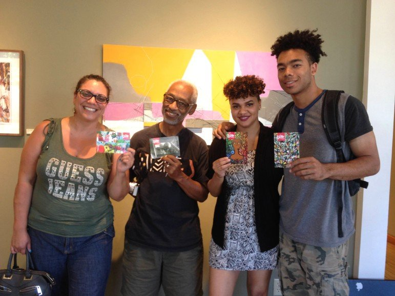 Four of the artists featured in FLOW's 10th anniversary postcard series showcase their work. L-R: Melodee Strong, Bill Cottman, Kayla Baribeau, Canaan Ray-Strong. (Photo by Author)