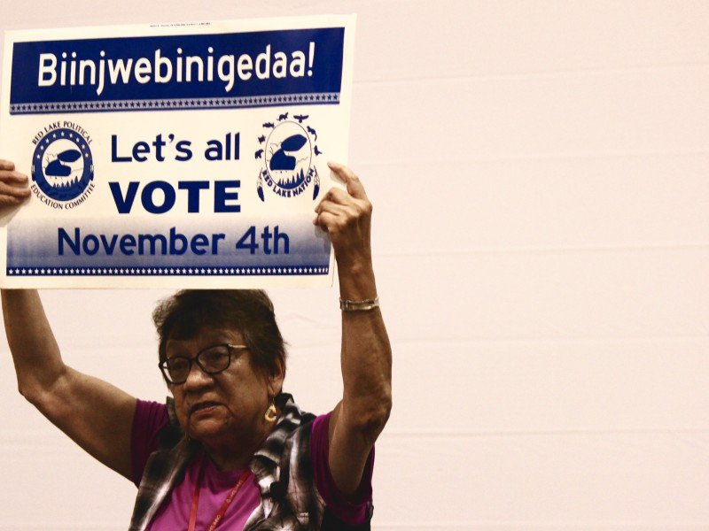 Stephanie Cobenais, a band member of the Red Lake Band of Chippewa Indians, holds up a sign she uses to encourage voting in her community during a panel discussion on the 50th anniversary of the Voting Rights Act.