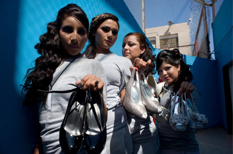 Women inmates at the Baja California state prison in Tijuana show their high heel shoes they will wear during the prison's first beauty pageant. Photo - David Maung, 2013 Tijuana, Mexico davidmaung@mac.com