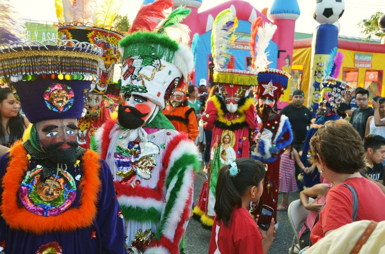 Traditional Chinelos dancers entering the celebration