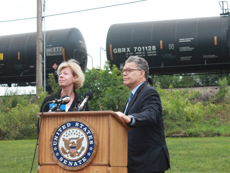 Senator Al Franken (D-MN) and Senator Tammy Baldwin (D-MN) at a recent press conference explaining the hazards of trains carrying crude oil.