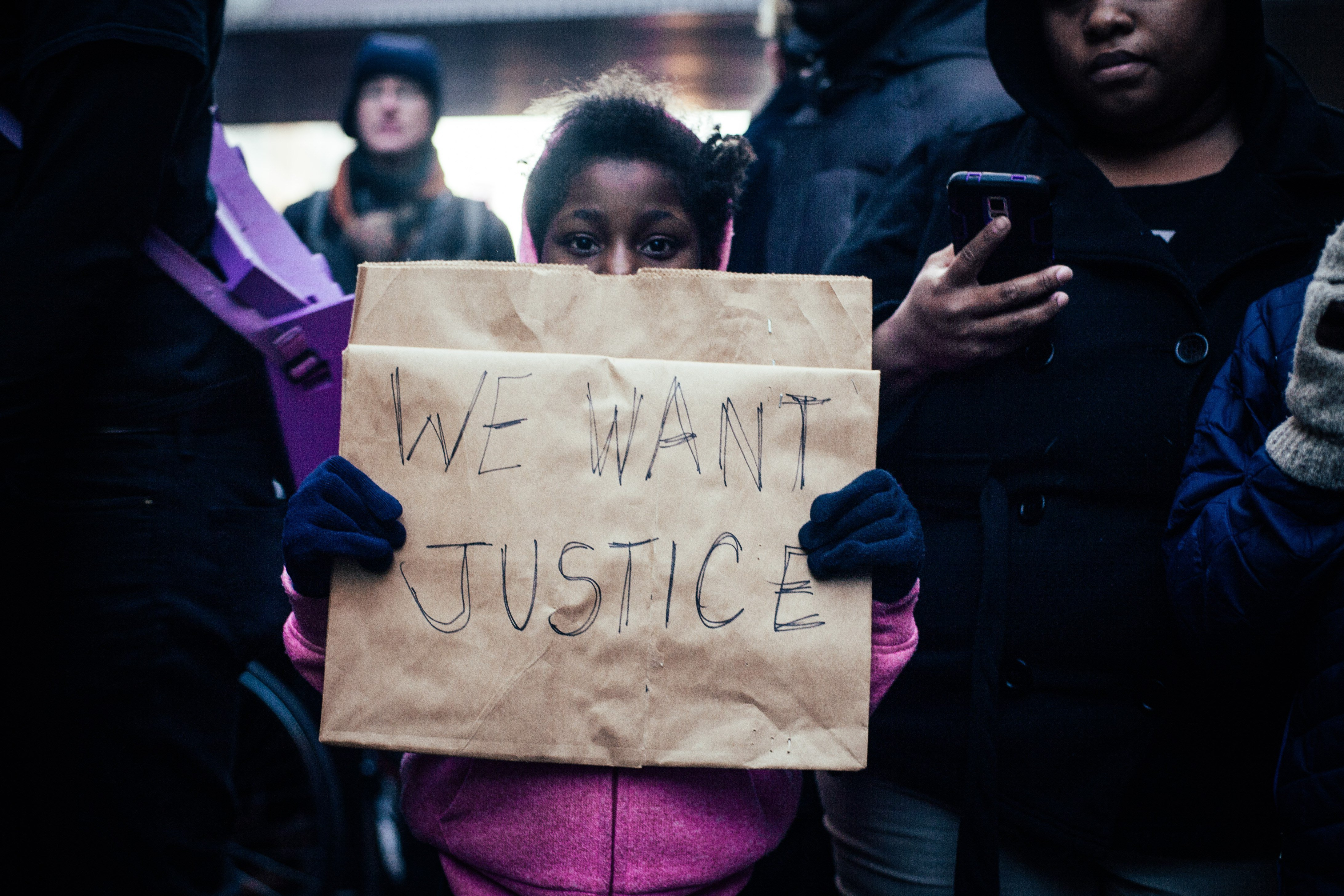 A young girl marches with protesters in downtown Minneapolis on Nov. 24