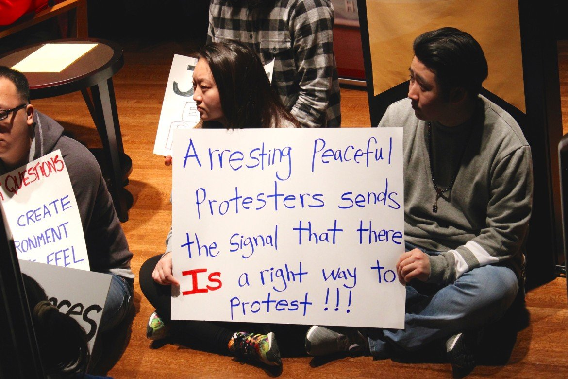"University of Minnesota student protesters disrupt a panel discussion on Feb. 11. The panel,  co-sponsored by UMN and Minnesota Public Radio, centered around the question ""Is there a right way to protest?"" Photo by Kayla Steinberg."
