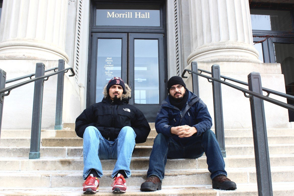 Rashaan Mahadeo (left) and David Melendez (right) sit on the steps of Morill Hall, where they were arrested in 2015 for protesting the University of Minnesota's commodification of diversity.