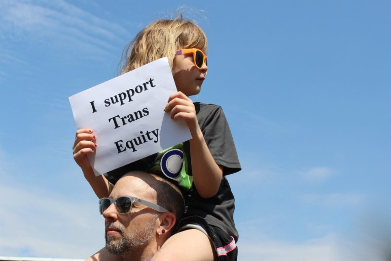 Aaron and Ezi Lichtov rally for trans equity at LGBT Lobby Day in St. Paul on April 14. Photo by Kayla Steinberg