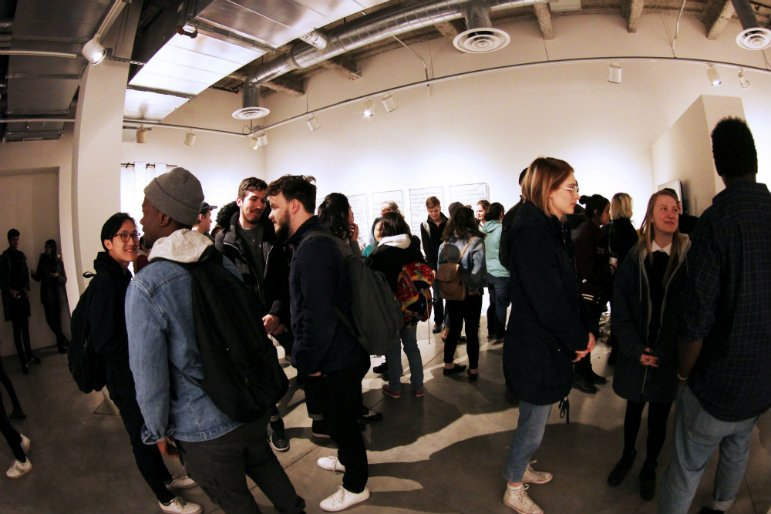 Minnesota College of Art and Design students gather at a recent gallery opening on campus. Photo taken by Nikki Rykhus