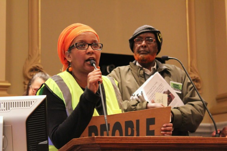 Ladan Yusuf (left) and Saciid Ali (right) address the Minneapolis City Council Committee of the Whole on March 30 to voice concerns about the future of Glendale Townhomes. Photo by Cristeta Boarini