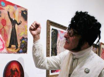Scott Seekins in front of his artwork. Photo by Nikki Rykhus.