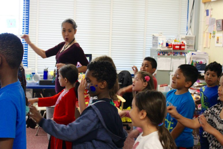 Maria Le, a first grade teacher at Central Park Elementary in Roseville, teaches a classroom of mostly students of color. Photo by Kayla Steinberg.
