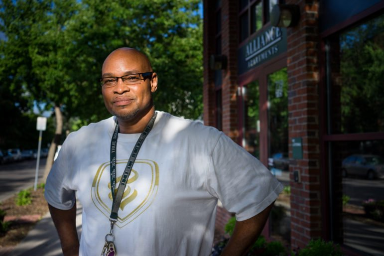 Robert Jackson stands in front of Alliance Housing, where he's been able to find a community and a home. Photo by Annabelle Marcovici.