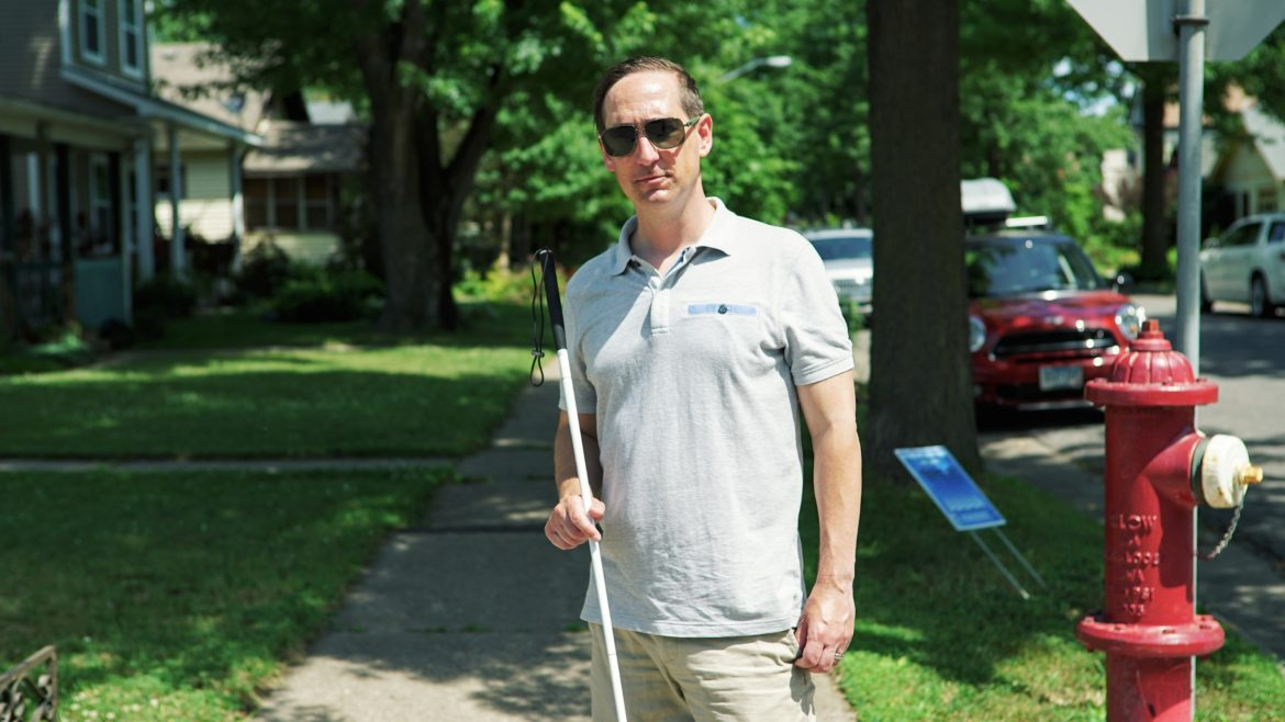 Scott Engel has a genetic disorder that has caused his vision to deteriorate for years. As a member of the Minneapolis Pedestrian Advisory Committee he has been able to shift city policy to prioritize pedestrian needs. Photo by Xiaolu Wang.
