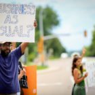 Michael Kleber-Diggs protests at the St. Anthony Police Department on Aug. 19 for the dismissal of Officer Jeronimo Yanez and for justice for Philando Castile. Photo by Thaiphy Phan-Quang.