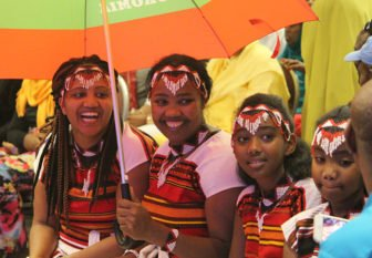 Four girls in traditional Oromo dress waiting to hear Olympic runner Feyisa Lelisa speak at the Minneapolis Convention Center last Friday. Photo courtesy of the Oromo Cultural Institute of Minnesota.