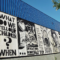 On July 7, 12 artists quickly organized to create a public, unsanctioned mural on an empty building to help the community heal. Five weeks later the building was demolished. Photo by Ryan Stopera.
