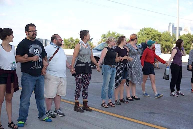 Protesters block northbound lanes of Interstate 35W during the morning rush-hour of July 13, 2016 to protest the death of Philando Castile. Photo courtesy of Filiberto Nolasco Gomez.