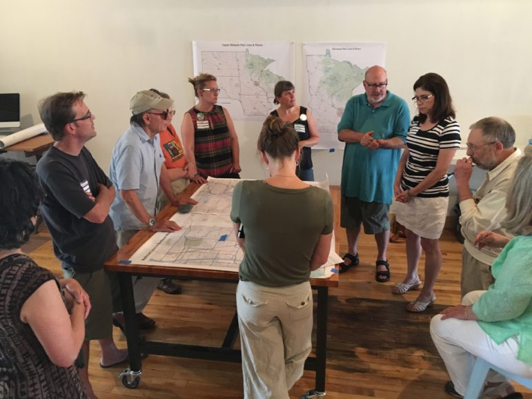 State Sen. Kari Dziedzic and state Rep. Frank Hornstein meet with local community activists about railroad safety and its impact on water issues at a Water Bar event with CARS-TC. Photo by Shanai Matteson courtesy of Water Bar.