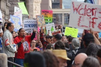 Protesters gathering outside Minneapolis City Hall. Photo courtesy of Chris Dang, Minnesota Daily.