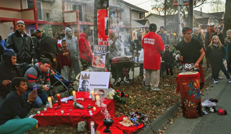 Community members hold an anniversary vigil for Jamar Clark on Nov. 15, 2016 at the street corner where he was shot by Minneapolis Police. Photo by Mark Peterson.