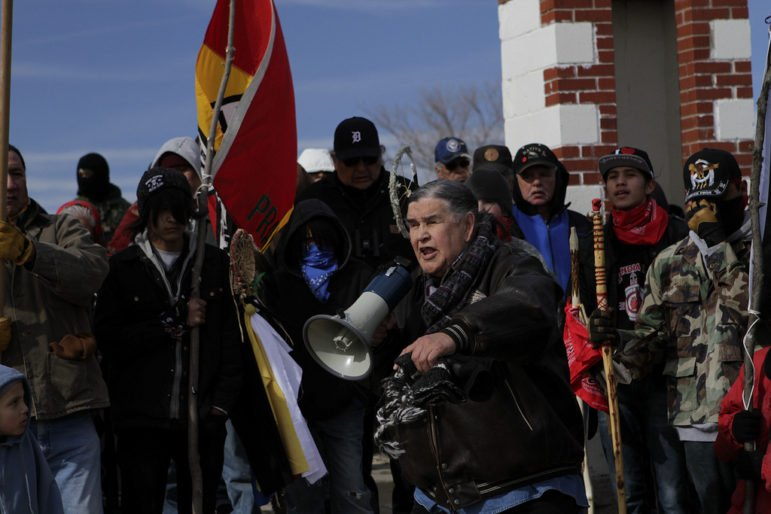 Clyde Bellecourt speaks at a February 2014 event commemorating the 1973 American Indian Movement demonstrations at Wounded Knee. Photo courtesy of Confrontational Media.