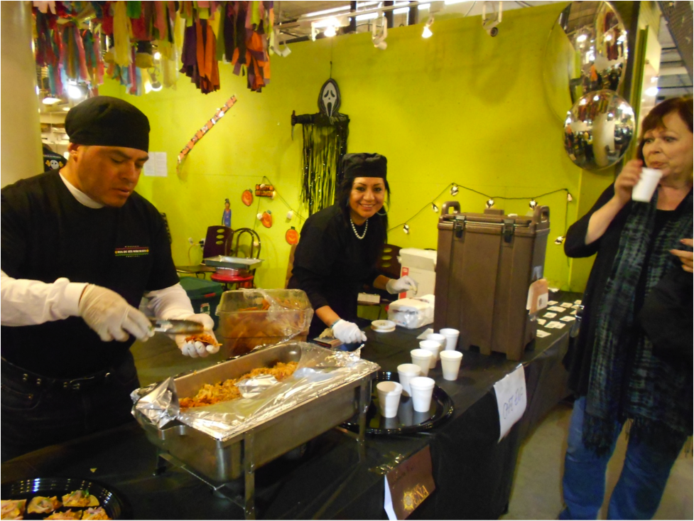 Café Ena, member of MERA-MN, serving samples at Global Market's Day of the Dead celebration 2012 (Photo: Erin Collins)