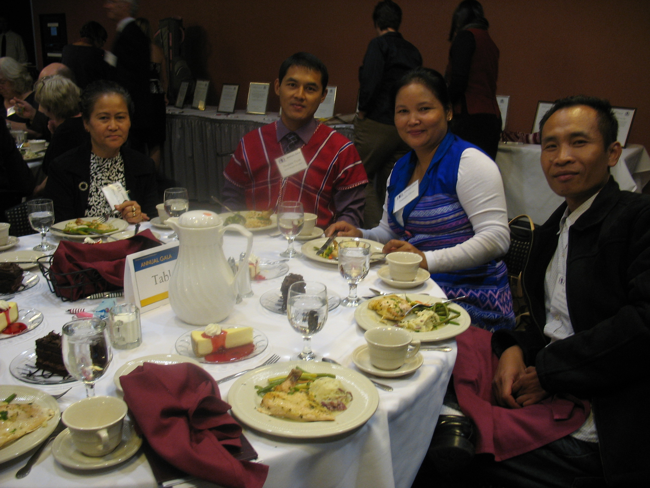Priscilla Aung, Hsajune Dyan, and other members of the Karen community in Minnesota eating dinner at the Karen Organization of Minnesota's 2nd Annual Gala on October 11, 2012. (Photo by Michelle Tran)