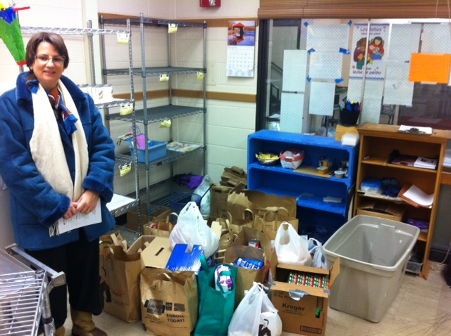 When the 4-H club arrived with a food donation, the shelves were bare. (Photo courtesy of Beth Breiter)