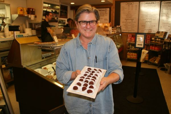 Head of catering Ann Richards shows off the homemade chocolate truffles. (Photos by Stephanie Fox)