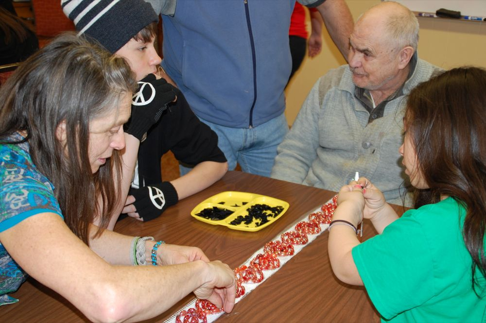 Allison and Gordon show students and a teacher from Barton Open School working with a Southwest Senior Center participant. (All photos courtesy of Mary Ann Schoenberger)