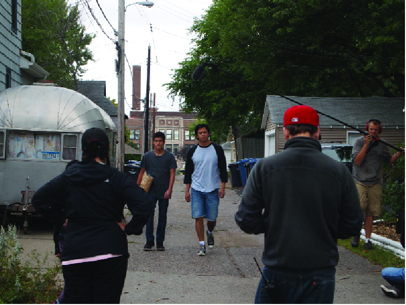 "Chaske Spencer (right) and Mauricimo Sanchez-Hohenstein have a conversation walking down the alley. Between scenes, Spencer said he does mostly bigger films but likes independent productions, too. ""This is a cool place, I like this town, it's definitely dope."""