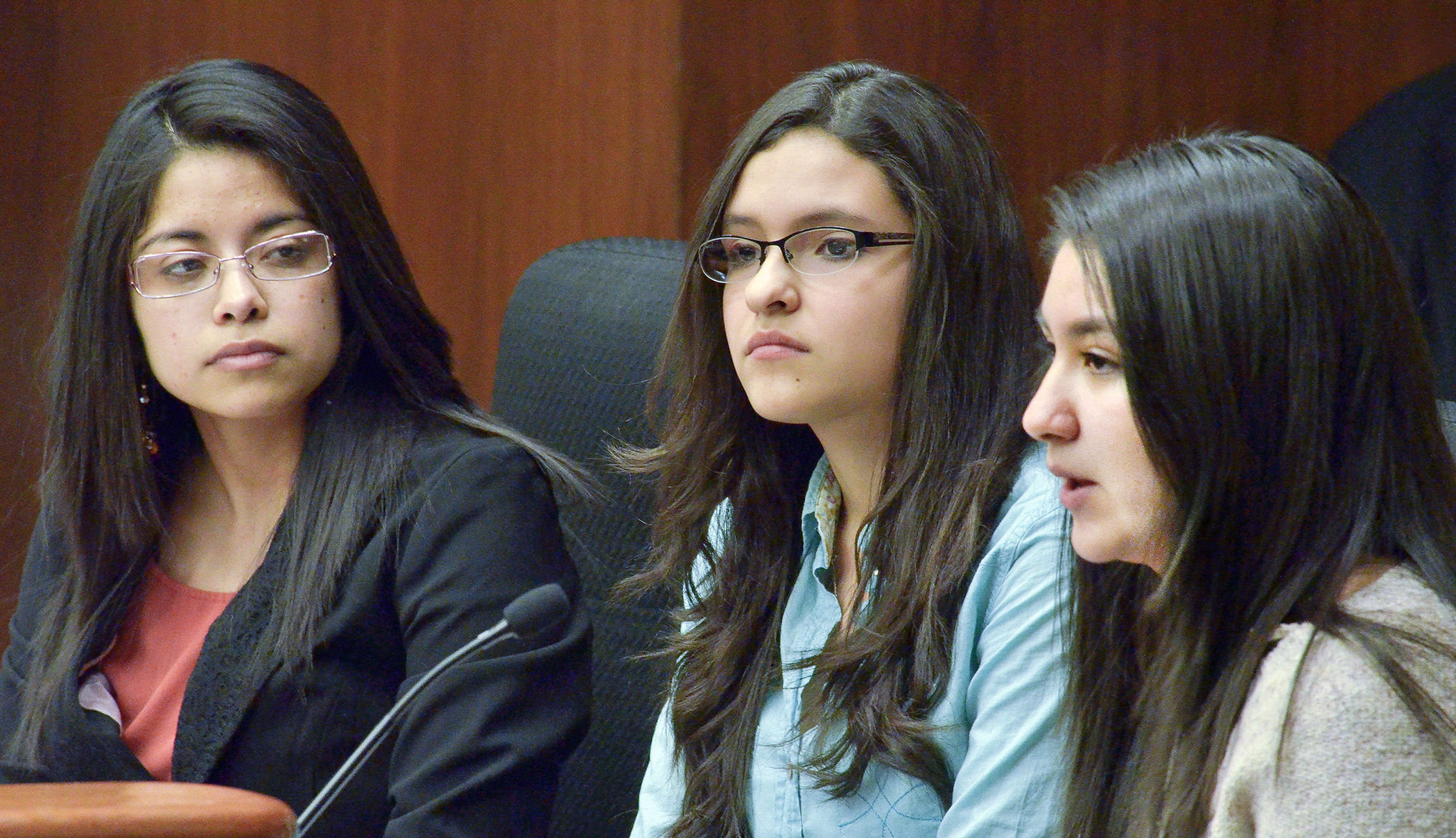 Karem Salas, from left, Thalia Estrada and Joycelin Hernandez testify before the House Higher Education Finance and Policy Committee April 3 in support of a bill that would provide unlawful immigrants treatment with respect to financial aid and tuition at public postsecondary institutions. (Photo by Andrew VonBank)