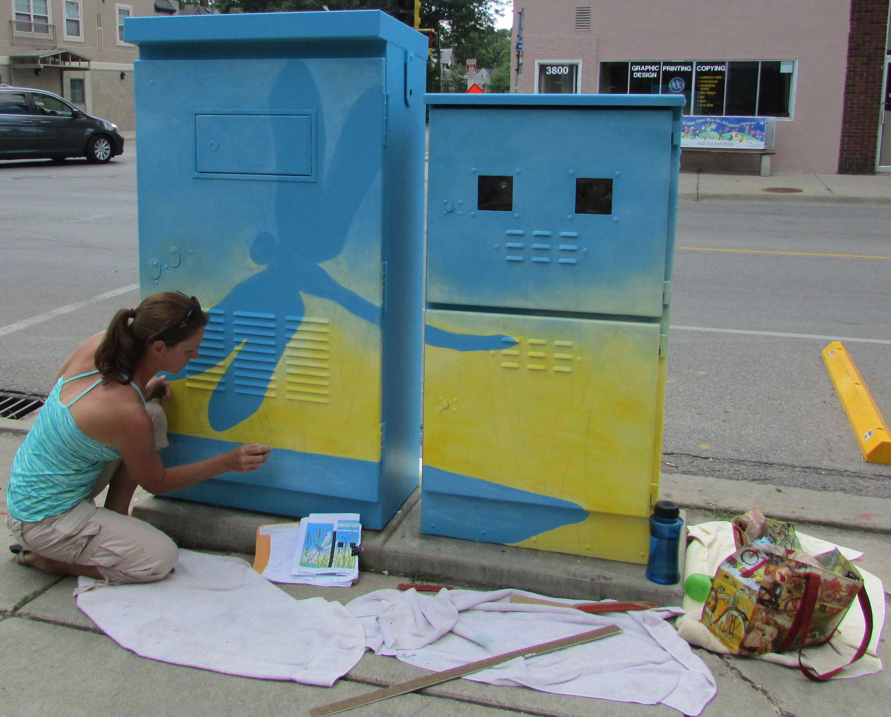 Julie Bode painting her box at the corner of 28th Ave. and 38th St.