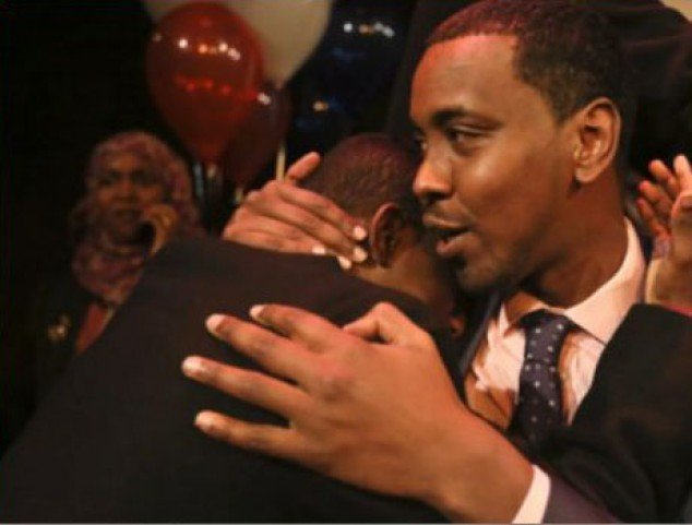Abdi Warsame hugs a supporter at his celebration party after winning the Minneapolis Ward 6 seat on November 5 2013 to become the first African-born person elected to the Council.