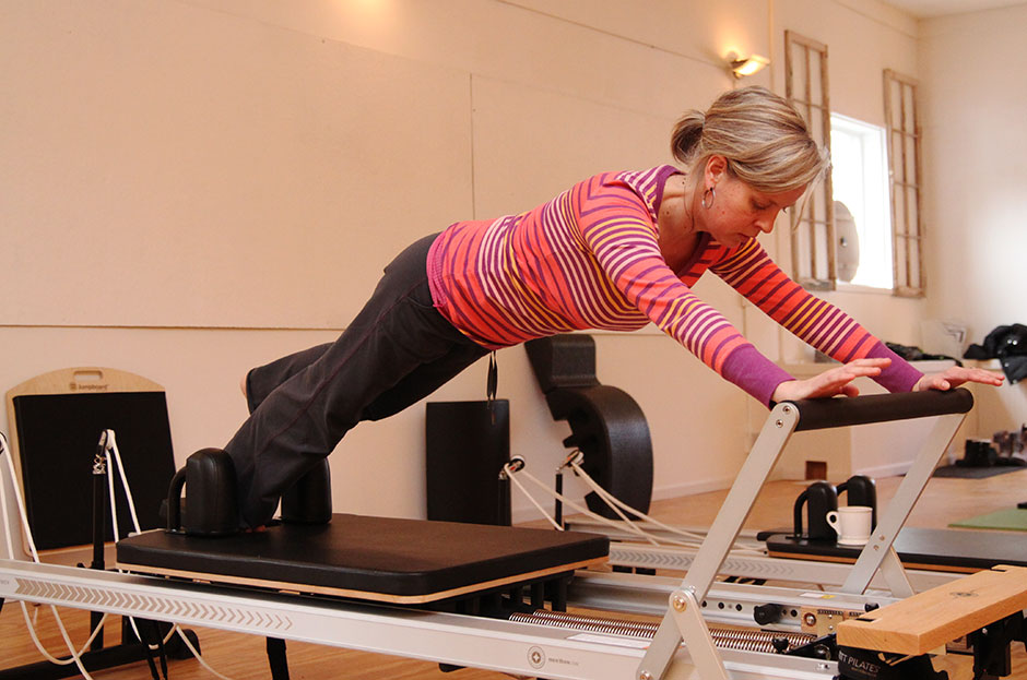 If you've been in a yoga class, you've probably done the plank. Here is a variation of plank on a Reformer machine. You'll feel it…everywhere.