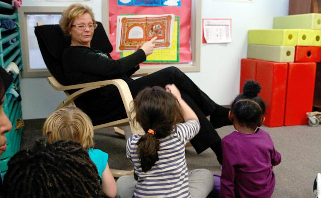 Preschool teacher Denise Taylor reading to a class of 4-year-olds at the Early Childhood Education Center at the Midtown YWCA. (MinnPost photo by Terry Gydesen)