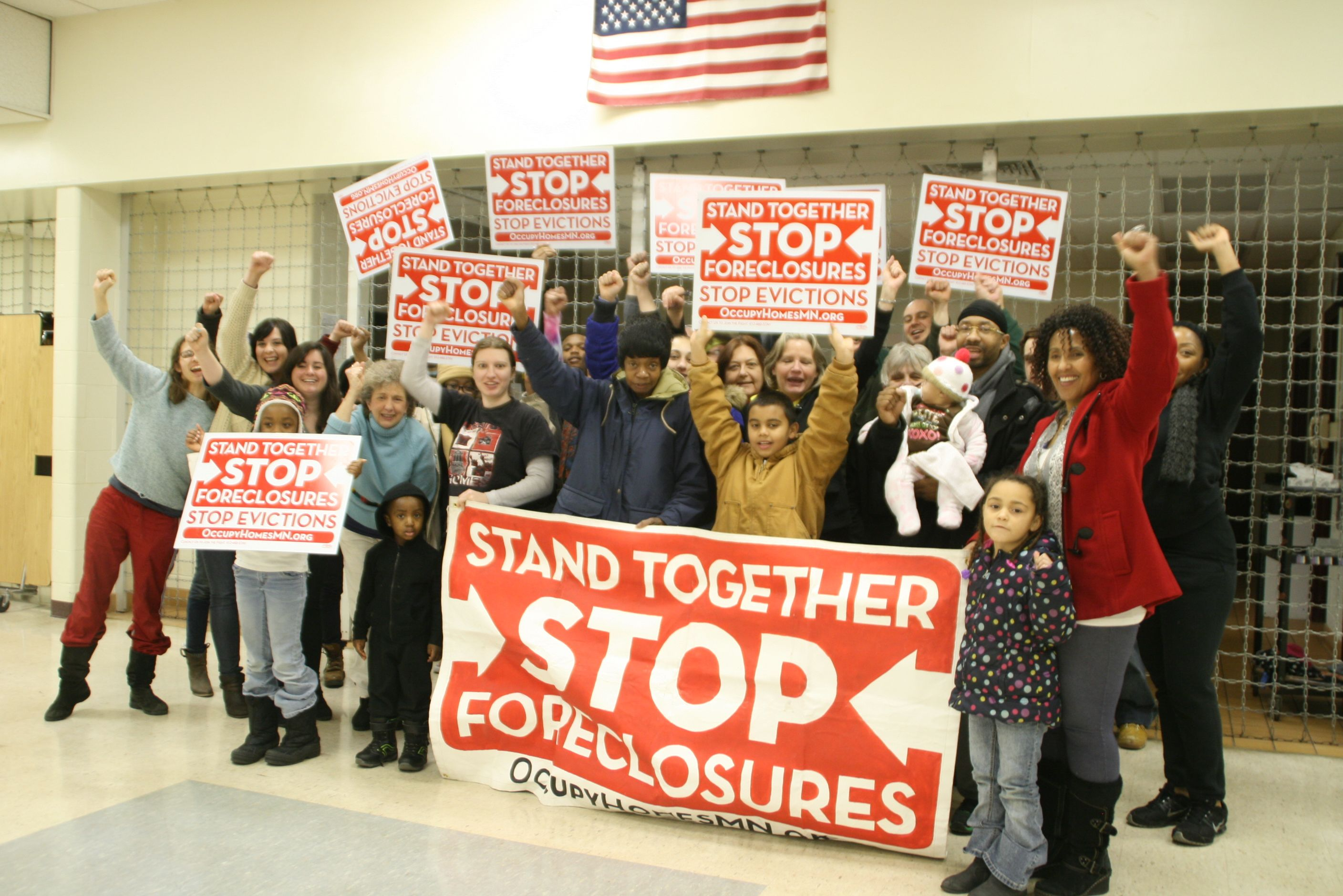 Protesters against foreclosure in Minneapolis's Central and Powderhorn neighborhoods pose for a photo and the Stand Up For Gayle potluck and organizing meeting last Saturday. (Photos by Stephanie Fox)