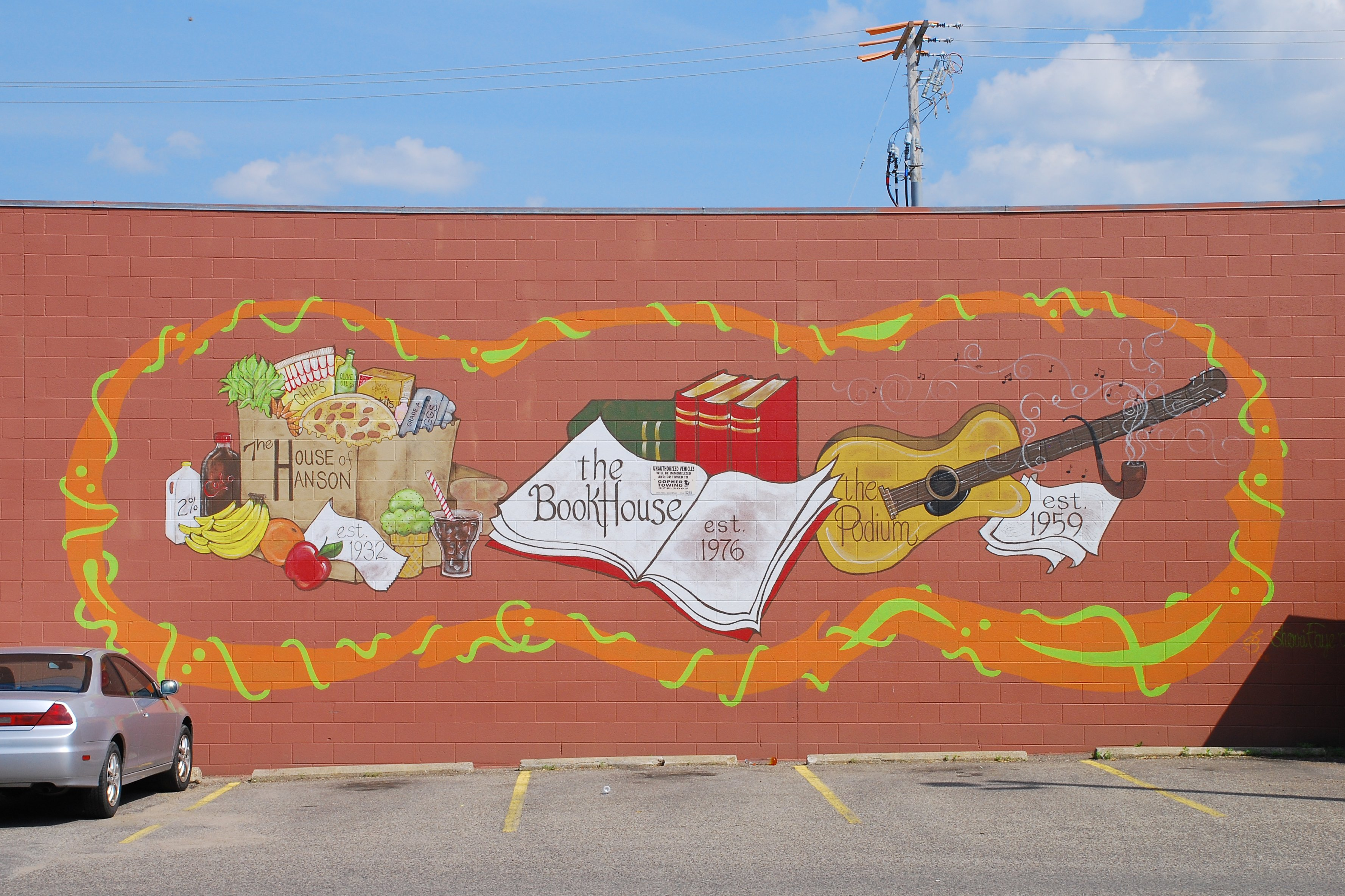 This mural, painted by Sherri Faye, the driver of Dinkytown shuttle bus Lucille, disappeared with the demolition of the three businesses that were in the building earlier in 2013. Faye said it was painted in 2009.