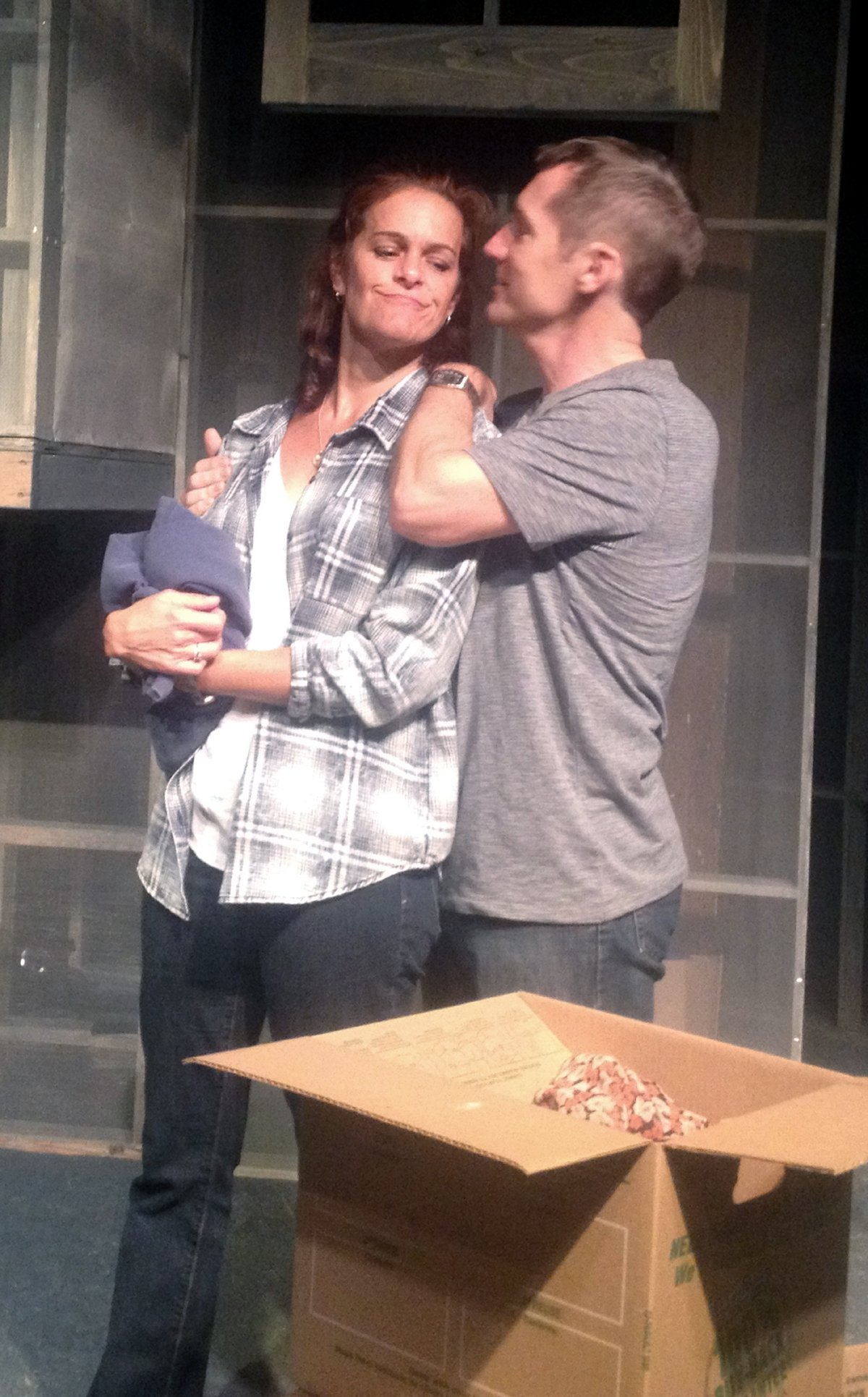 Claire (Kersten Rodau) and Jason (Doug Scholz-Carlson) moving in together in Nautilus Music-Theater's production of Ordinary Days