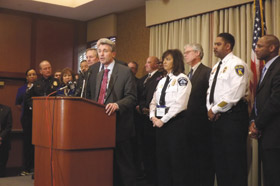 Minneapolis Mayor R.T. Rybak, flanked by a group of Midwest mayors and public safety officials, addresses reporters during the Midwestern Regional Gun Summit.
