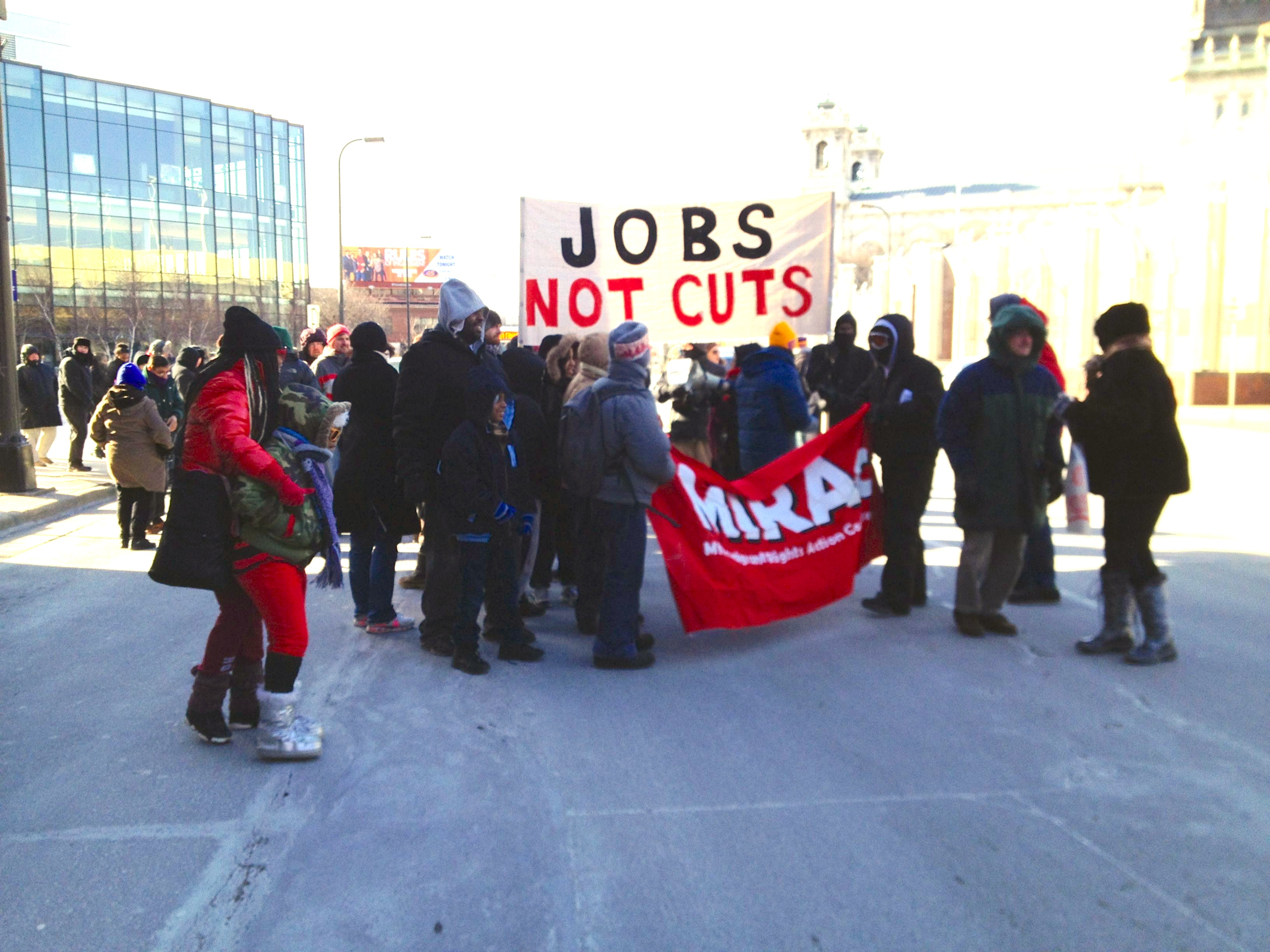 Occupy MN marchers go down Hennepin Avenue from MCTC.