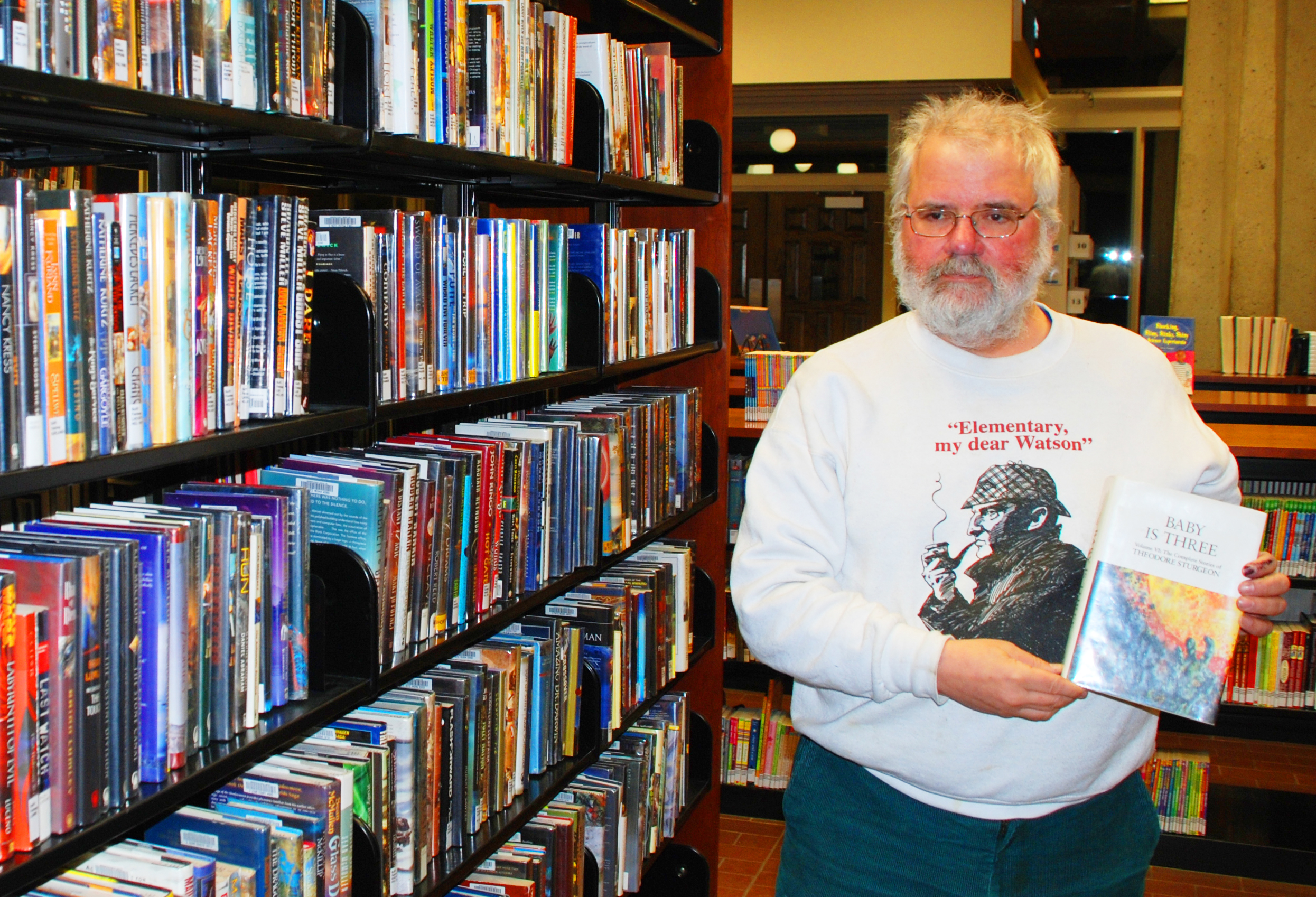 Eric Heideman with one of his favorite sci-fi books, a collection of stories by Theodore Sturgeon.